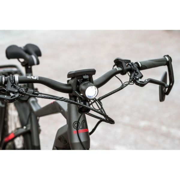 image showing detail of handlebar area with bright light, horn, mirror, magura hydraulic disc brakes
