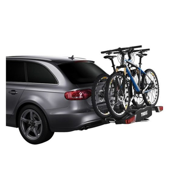 image showing thule bike rack loaded up with 2 bikes on a car